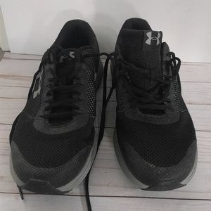 Black Running shoes by Under Armour